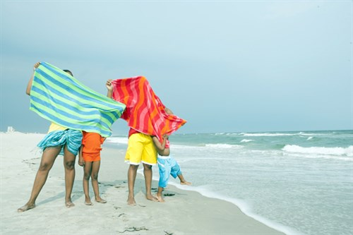 Family With Beach Towels On Beach Rto3ersj